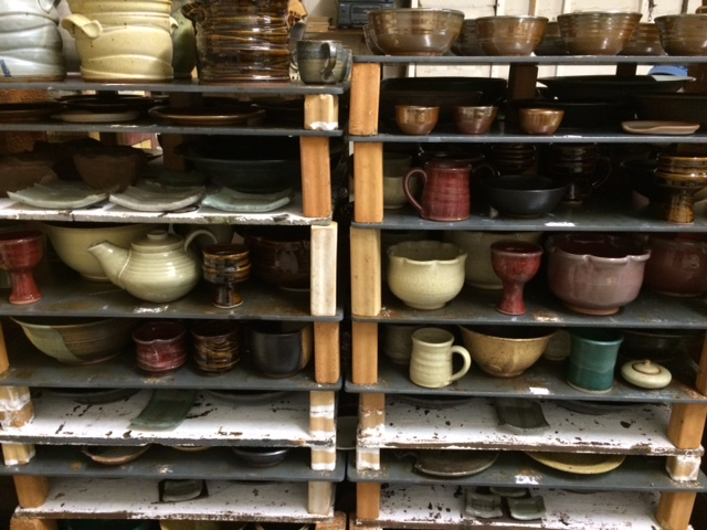 Still hot from the Kiln cone 10 stoneware and porcelain pieces cooling before being taken off the shelves.